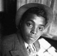Portrait of a young boy in formal dress, Genadendal, South Africa