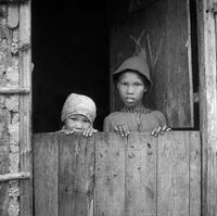 Two young girls standing in a doorway, Genadendal, South Africa
