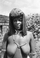 Zulu woman wearing braids and headdress