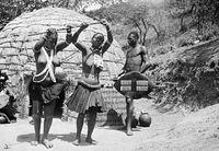 Zulu women and man doing a traditional dance