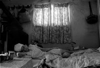 Elderly woman on bed, South Africa