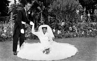 Bride and groom in garden on their wedding day, Eastern Cape, South Africa