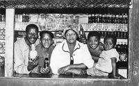 Showing off cooldrinks and a pineapple over a shop counter, East Bank, Eastern Cape, South Africa