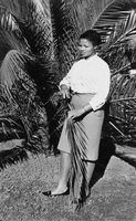 Woman posing for a portrait holding a plant, Eastern Cape, South Africa