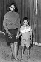 Woman posing with young boy in school uniform, Eastern Cape, South Africa