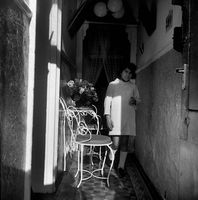 Girl standing in corridor, District Six, Cape Town, South Africa