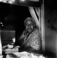Woman in the window of her home, District Six, Cape Town, South Africa