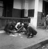 Boys playing with cards on the pavement, District Six, Cape Town, South Africa
