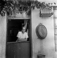 Woman standing in a doorway, District Six, Cape Town, South Africa