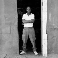 Man standing in doorway, Mai Mai hostel, Johannesburg, South Africa