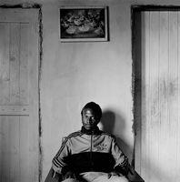Man sitting in Mai Mai hostel, Johannesburg, South Africa