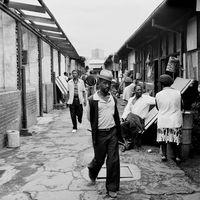 Men and woman outside the Mai Mai Hostel, Johannesburg, South Africa