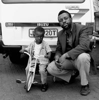 Man with young child, Mai Mai Hostel, Johannesburg, South Africa