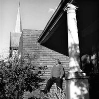 Man in garden, Troyeville, Johannesburg, South Africa