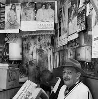 Men behind a counter, Johannesburg, South Africa