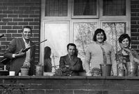Family on front stoep of their home, South Africa