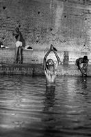 Man carrying out spiritual ritual in water, India
