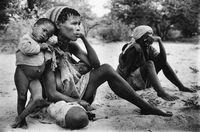 San woman with her child, Botswana