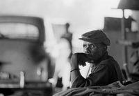 Man sitting on roadside, South Africa