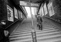 Man descending a stairway, London, England