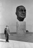 Man standing next to statue, South Africa