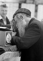 Bearded man sleeping at table. Jerusalem, Israel