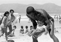 Father and child on the beach, Cape Town, South Africa