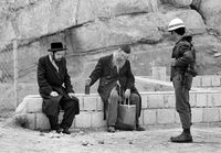 Jewish men being approached by a policeman, Jerusalem, Israel