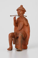 Figurine of a man playing setolotolo musical bow