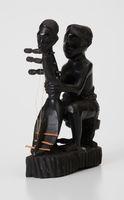 Figurine-man holding shoulder harp