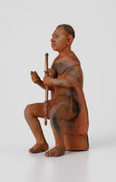 Figurine of a man playing the thomo musical bow