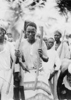 [Close up of African men dancing with sticks]