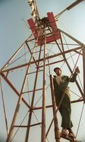 An unidentified park ranger using a wind pump as a lookout