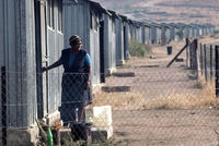 Forcibly removed woman outside shack, South Africa