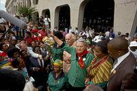 Ray Alexander Simons with husband on return to South Africa, Johannesburg