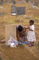Daughter of Sharpeville massacre victim mourns beside his grave, Vereeniging, South Africa